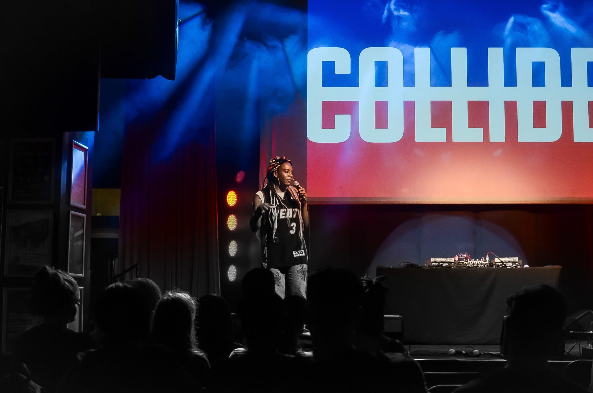 Naomi on stage speaking at Collide event