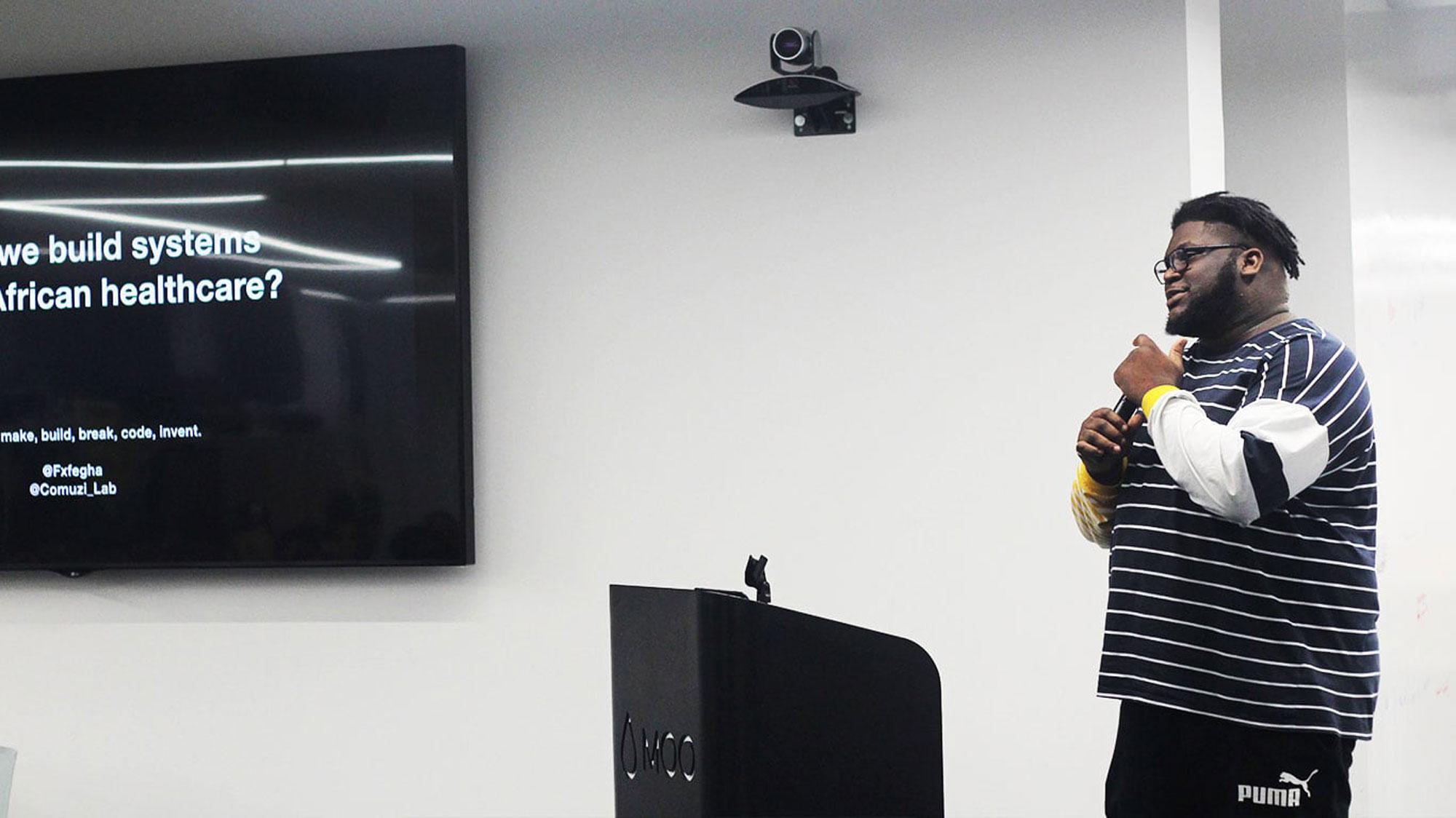 Alex Fefegha speaking at event